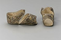 Pair of sandals     Italian, 1580–1680     Italy MFA - Museum of Fine Arts Boston White silk embroidered on vamps, quarters and soles with silver and gilt-silver yarns with polychrome silk details; silver binding; Baroque vegetative motifs. Open toes and sides. Latchets on quarters with metallic yarn button closures. White silk linings. Stiffened with cardboard. The Elizabeth Day McCormick Collection