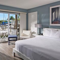 Wake up to bay views when you stay at the Cove Inn in Old Naples, Florida.