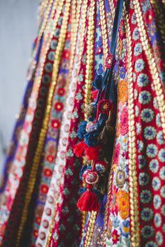 Bridal Details - Bridal Threadwork Sabyasachi Lehenga with Red and Blue Pom-Poms Indian Skirt, Indian Dresses, Indian Wedding Outfits, Indian Outfits, Indian Clothes, Sabyasachi Lehenga Bridal, Ghagra Choli, Lehenga Wedding, Anarkali