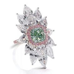 Leviev Diamonds. An exceptional cushion-shaped Fancy Intense Green Diamond highlighted by Pink pave and mounted with pear-shaped White Diamonds totaling 11.08 carats.