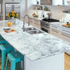 Formica's new Bianca Luna laminate mimics white quartzite but won't leave you stone broke. Its realistic pattern repeats every 5 feet, and, with IdealEdge trim in bullnose, the sides look seamless. | thisoldhouse.com