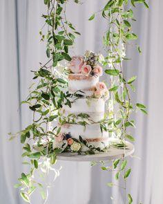 Trending Now: Floating Wedding Cake Tables #FloatingCakeTable #FloatingWeddingCakeTable #WeddingCakeIdeas #WeddingCakes | Martha Stewart Weddings - Trending Now: Floating Wedding Cake Tables