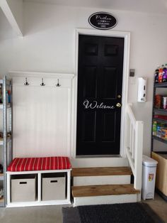 Mudrooms provide a place to store shoes, coats, and pretty much anything else that could bring unwanted parts of the outdoors into your home. But they needn't be actual rooms of their own. Hooks, a place to sit and remove shoes, and a painted door can create a mudroom and welcoming vibe in your garage.