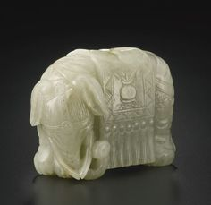 A WHITE JADE CARVING OF AN ELEPHANT. QING DYNASTY, 18TH 19TH CENTURY.