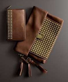 The Legacy Lock Clutch in Studded Leather and the Legacy Continental Zip Wallet in Studded Leather from Coach