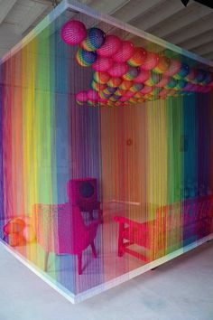 Designer Pierre le Riche created this yarn-bombed rainbow room (complete with rainbow acrylic-thread curtains)