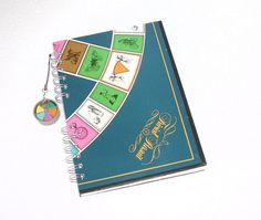 trivial pursuit board notebook with playing piece charm