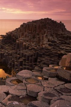 Giants Causeway, an area of about 40,000 interlocking basalt columns, the result of an ancient volcanic eruption. It is located in County Antrim on the northeast coast of Northern Ireland.