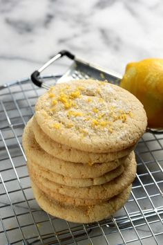 This extremely simple and surprisingly delicious recipe for Lemon Coconut Sugar Cookies is a must! Keep your ZestN'est handy to add fresh lemon zest to these cuties.  Learn all about ZestN'est here: http://newmetrodesign.com/content/ZestNest.html