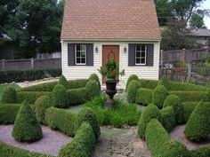 Beautiful garden shed with knot garden