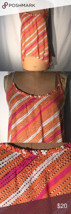 AEO hi-lo diag stripe cotton voile festival cami American Eagle Outfitters diagonal, variegated stripe high-low cami just in time for festival season. Super lightweight orange/fuchsia/white/black cotton blend voile so you keep your cool even when the band & the climate are too hot. Cotton 60% & viscose 40%. Adjustable double spaghetti straps that criss-cross in back with beaded tassels. **Please note tiny flaw on strap (close-up photo)..** The viscose gives even more coolness to the fabric…