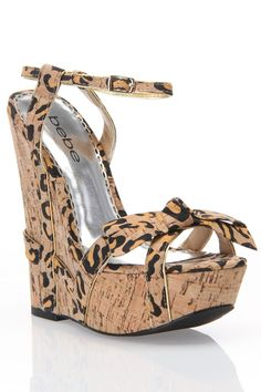 I love wedges because they are easier to walk in than stilettos. Bebe Faithful Wedges In Natural Combo - Beyond the Rack