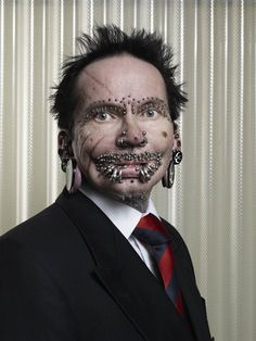 Most piercings on a male    The most pierced man, Rolf Buchholz, has 453 studs and rings all over his body. Buchholz, from Dortmund, Germany, has – among others – 94 piercings in and around his lips, 25 in his eyebrows, eight in his nose and 278 in his genital area.