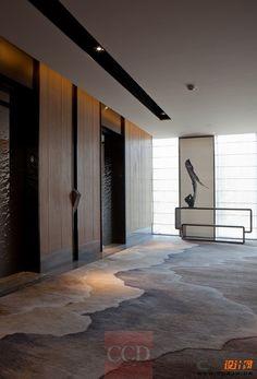Lift lobby with decorative broadloom carpet detail                              …