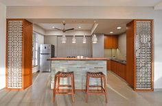 Discover various asian style kitchen photo gallery showcasing different design ideas. Wooden Bar Stools, Wooden Dining Tables, Architectural Design Magazine, L Shaped Modular Kitchen, Decorative Tile Backsplash, Wood Plank Ceiling, Asian Kitchen, Low Cabinet, White Countertops