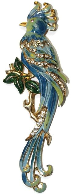 Coro named this large enamel bird Big Parrot. It is signed CORO on the back. The patent number is 128822 issued to Adolph Katz on August 12, 1941. It