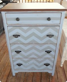 "quote """"Thistle Blue"" from Martha Stewart and painted the chevrons and stripe with a hand mixed gray.  The top is stained my good ol' fave, Minwax Dark Walnut.  ...  Since it was missing one of the original pulls, I used some knobs from my (large) stash on the top drawer, and used the original pulls on the bottom three drawers.  I sprayed all the pulls with some Oil Rubbed Bronze from Krylon."""
