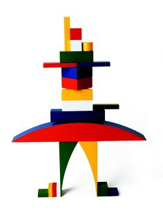 """Building Game """" Bauhaus Bauspiel"""" still manufactured by Nauf in Switzerlan was designed by Alma Siedhoff-Buscher in 1923.  In 1922 she entered the Bauhaus. In connection with the major Bauhaus exhibition of 1923, she designed the furnishings of the children's room in the prototype Am Horn house & participated in Ludwig Hirschfeld-Mack's Colour-Light Games. She also created various children's toys such as the Small Ship-Building Game and a puppet theatre."""