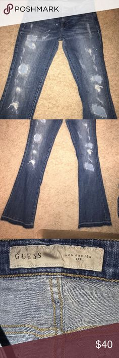 Adorable Guess Distressed Patchwork Bootcut Jeans Super cute Guess Jeans  GUESS PREMIUM DAREDEVIL DISTRESSED DESTROYED RIPPED JEANS. Iconic Guess Triangle Logo on back pocket. These are the Jeans that started it all . The Best Butt Jeans ever . Classic five pocket style in a bootcut . Obviously intentionally distressed . Size 30.   Preloved distressed destroyed intentionally . Some cuff wear see photos Guess Jeans Boot Cut