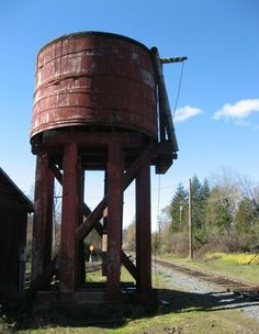This old, wooden water tank still stands at the ready along the old California Western Railroad (the Skunk Train) tracks just as they head west to Northspur and Ft. Bragg far beyond.