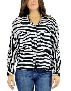 (CLICK IMAGE TWICE FOR DETAILS AND PRICING) Optical Illusion Striped Blouse Black_White. Team this slouchy blouse with a bright colored bottom and neutral shoes.. See More Tops at http://www.ourgreatshop.com/Tops-C74.aspx