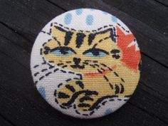 Button made with vintage 1959 Girl Scout fabric... perfect little kitty! <3