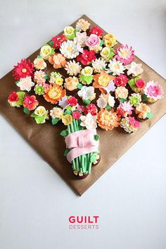 Red Velvet Cupcakes topped with beautiful fondant flowers, arranged into a beautiful bouquet…