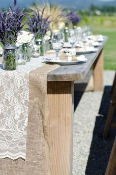 Burlap and lace table covers for a rustic Tuscan wedding What do you think of this idea the burlap with the lace and then maybe something blue or yellow under. Get Dru to build a table like that for the head table.