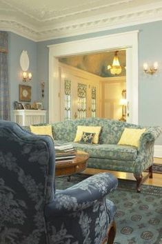 If doors on every wall of your living room are stumping you as to where to place your furniture, don't worry about the wall space. Bring your furniture in toward the center of the room. By centering your main seating area, you create a cozy conversation space for entertaining and a relaxing place to lounge without ... #howtoarrangingbedroomfurniturespaces