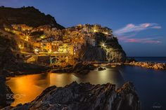 Popular on 500px : Manarola blue hour the last shot by IbizaHippyPhoto
