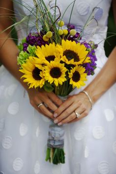 purple yellow gray weddings | Yellow sunflowers and craspedia really popped against a background of ...
