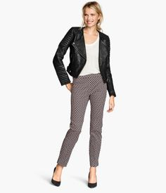 H&M: These black/white pattern pants are perfect to wear with a fierce moto jacket like what the model is in and even for work!