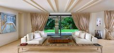 camere de zi , Beautiful living room goes horizontal with decor 600x280