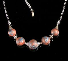 Planet Cluster polymer clay bead necklace. From mindfulmatters on etsy