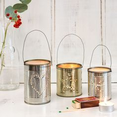 Upcycle simple tin cans and turn them into twinkling lanterns - line up two or three in a row for a homemade Christmas decoration with plenty of natural charm.