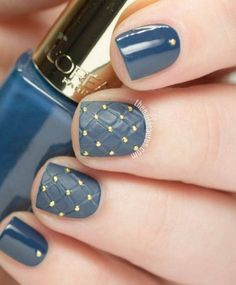 """What says """"cold weather"""" more than warm blankets? This matte manicure plays with texture via chic gold dots.   Get the tutorial on The Nailasaurus »"""