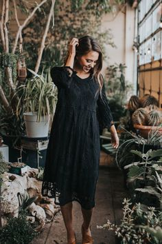 Steal the show in this deep black, knee-length dress. The lace overlay creates a flirty appeal while still keeping you comfortably covered. Wear it all year long! We don't judge. Model is wearing a S/