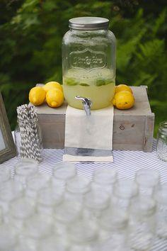 lemonade drink stand #drinkstation http://www.weddingchicks.com/2013/12/11/seaside-wedding-2/