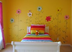 Oh, I would never have thought that yellow would look so cute in a little girls room.  The flowers are so fun.