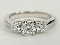 Striking and elegant, this 3-stone diamond ring is crafted in platinum and is perfect for those who prefer to choose both the sidestones and center diamond.