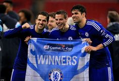 Chelsea's Cesc Fabregas (left), Cesar Azpilicueta (centre) and Diego Costa with their winners' flag after the final whistle
