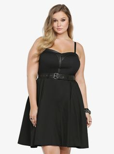 Rocking a sexy sweetheart neckline that is lined in black faux leather, this versatile black A-line dress has removable, adjustable spaghetti straps. Made by Tripp NYC, the flirty LBD has a matching faux leather black belt that brings the whole look together.