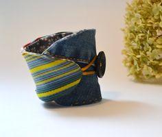 repurposed jeans wrist cuff blue jeans diagonal by redstitchlab. Cute idea - would make a fun coffee cuff!