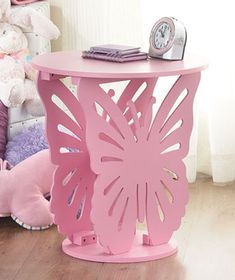 Your decor will take flight on the wings of a wooden Butterfly Shaped Table. Clever design uses a die-cut butterfly as its base. The wings feature detaile