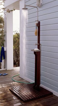outdoor shower on back of garage