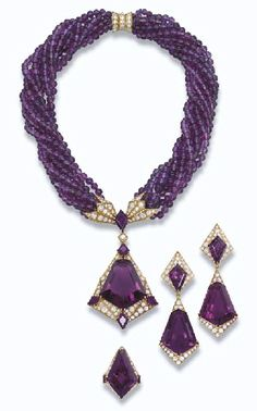 PROPERTY OF A ROYAL HOUSE: AN AMETHYST AND DIAMOND SUITE, BY FRED The necklace designed as a kite-shaped amethyst within a pavé-set diamond surround to the lozenge-shaped amethyst spacer suspended from nine rows of amethyst beads gathered by pavé-set diamond clasps, ear pendants and ring en suite.