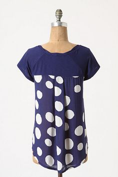 May try making this. Regular shirt on the front, pattern in see-through fabric on the back.