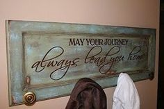 Old cabinet door turned coat rack. Love the quote too