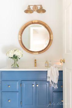 See how we transformed a dark, dated bath with fresh new nautical bathroom decor in this bathroom refresh with a beautiful blue hue! Nautical Bathroom Accessories, Nautical Bathroom Decor, Bohemian Bathroom, Bathroom Inspiration, Home Decor Inspiration, Bathroom Ideas, Small Bathroom, Downstairs Bathroom, Bathroom Designs