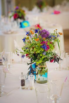 Jar Flowers Colourful Relaxed Country Outdoor Flowers Bright Summer Wedding http://www.photographybyvicki.co.uk/